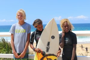 Solwata Sista team members and school student who donated his board at Surfest