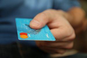 Man handing over credit card